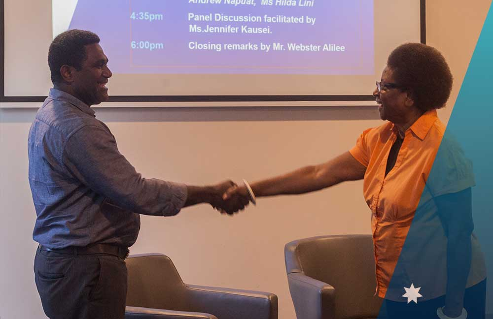 MP Johnny Koanapo greeting Ms. Hilda Lini at the start of the session about Life in politics